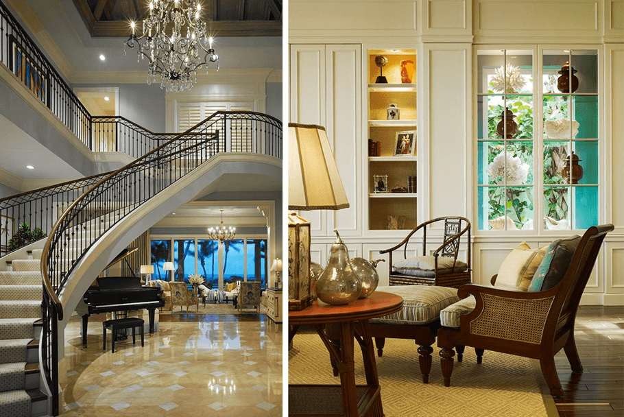 A Large Staircase Underneath A Chandelier And Two Traditional Luxurious Chairs.