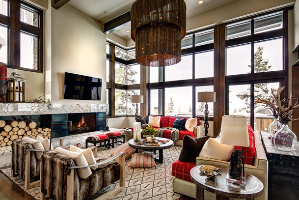 Rustic Designed Living Room With A Fireplace And Chandelier.