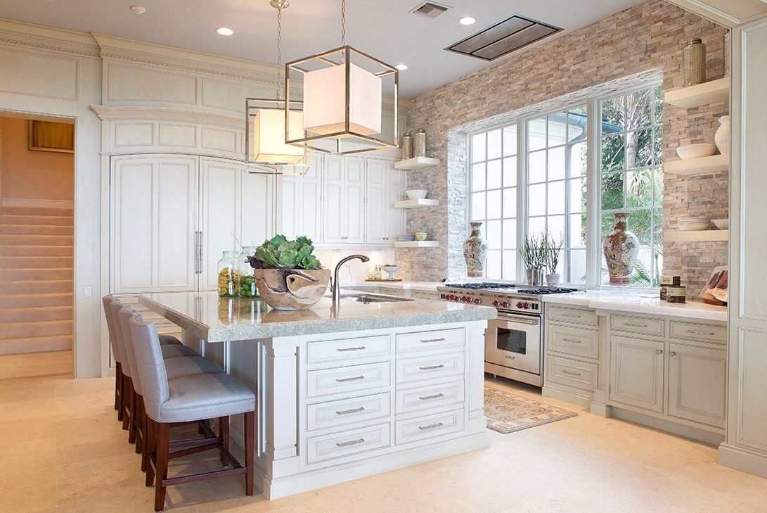 Brightly Lit Country-style Kitchen With Light Fixtures Above An Island.
